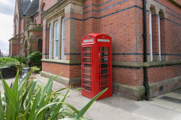 Wigan's red phone boxes given grade II listing.
